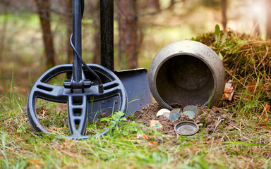 Obraz Search for treasure using a metal detector and shovel. - fototapety do salonu