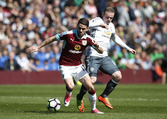 Burnley's Robbie Brady in action with Manchester United's Wayne Rooney