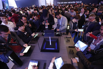 Visitors check new Samsung Tab S3 devices during an event at Mobile World Congress in Barcelona