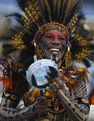 A reveller from Beija-Flor samba school performs during the carnival parade at the Sambadrome in Rio de Janeiro