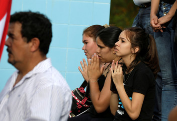 Friends, family and neighbors of Rodrigo Quintana, who was killed by a rubber bullet fired by the police in the headquarters of the Liberal Party after clashes, attend his funeral in La Colmena