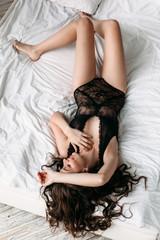 Beautiful girl in bed in the bottom black underwear