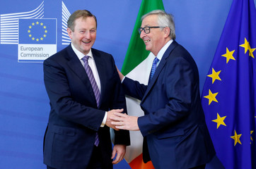 EU Commission President Juncker poses with Irish PM Kenny in Brussels