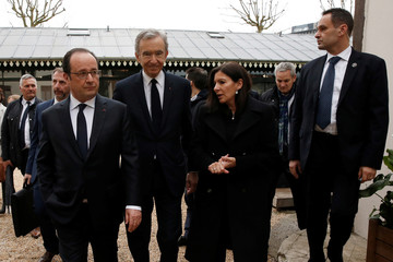 French President Hollande, Chairman and CEO of LVMH Arnault and Paris Mayor Hidalgo leave after a news conference to announce a new architectural project lead by LVMH in the 'Bois de Boulogne' in Paris