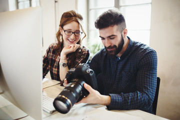 Company photo editor and photographer working together