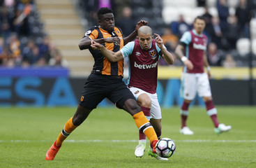 Hull City's Alfred N'Diaye in action with West Ham United's Sofiane Feghouli