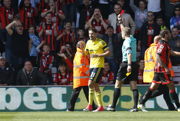 Middlesbrough's Gaston Ramirez is shown a red card by referee Graham Scott