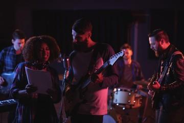 Singers singing in studio