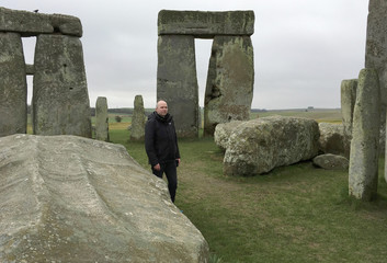 Doctor Rupert Till, music technologist from the University of Huddersfield, poses for a photograph in the stone circle of the ancient monument of Stonehenge, Amesbury
