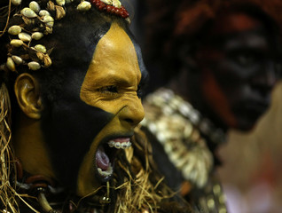 A revellers from Uniao da Ilha samba school performs during the second night of the carnival parade at the Sambadrome in Rio de Janeiro, Brazil