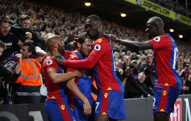 Crystal Palace's Yohan Cabaye celebrates scoring their second goal with team mates