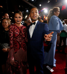 """Soundtrack artist Legend and his wife Teigen attend the premiere of """"Beauty and the Beast"""" in Los Angeles"""