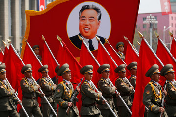 Soldiers march by a portrait of North Korea's founding father, Kim Il Sung during a military parade marking his 105th birth anniversary in Pyongyang
