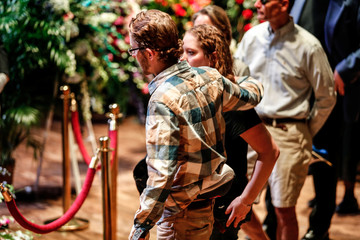 Fans embrace as they pay their respects to the late rock 'n' roll visionary Chuck Berry at his funeral at The Pageant club in St. Louis