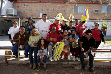 Honduras migrants Orlando Rubi, his wife Lizeth Bonilla and son Jose Luis pose for a picture with other immigrants and staff members of the migrant shelter during a birthday celebration in Ciudad Juarez