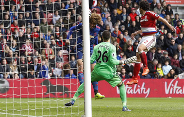 Manchester United's Marouane Fellaini scores their first goal