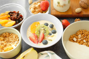 Composition with tasty yogurt and different products on table, closeup