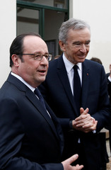 French President Hollande and Chairman and CEO of LVMH Arnault leave after a news conference to announce a new architectural project lead by LVMH in the 'Bois de Boulogne' in Paris