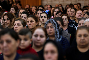 Iraqi Orthodox Christians attend a prayer session inside Syriac Orthodox Church of Mart Shmoni during Good Friday prayers in Erbil