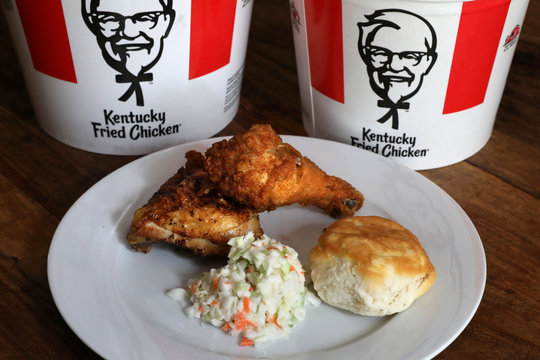 A Kentucky Fried Chicken (KFC) plate of mixed fried and grilled chicken with a biscuit and coleslaw is seen in this picture illustration