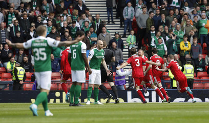 Aberdeen's Adam Rooney celebrates scoring their first goal with team mates