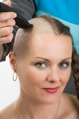 beautiful middle age woman cancer patient shaving hair