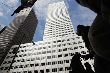 The building at 666 Fifth Avenue, owned by Kushner Companies, rises above pedestrians in New York