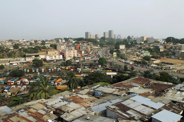 Buildings in the business district Plateau are seen behind the village of Attiekoube in Abidjan