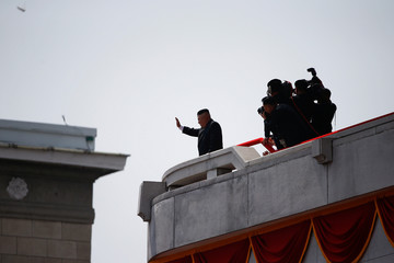 North Korean leader Kim Jong Un waves to people attending a military parade marking the 105th birth anniversary of country's founding father in Pyongyang