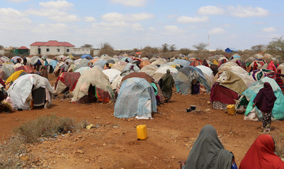 Internally displaced Somali women who fled from drought stricken regions arrive at a makeshift camp in Baidoa, west of Somalia's capital Mogadishu