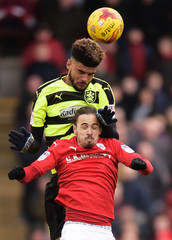 Huddersfield Town's Philip Billing and Barnsley's Ryan Williams in action