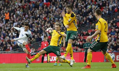 England's Dele Alli shoots at goal