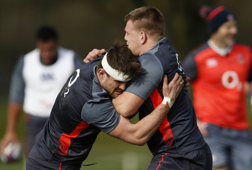 England's Jack Clifford (L) during training