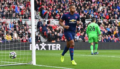 Manchester United's Antonio Valencia celebrates scoring their third goal