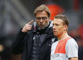 Liverpool manager Juergen Klopp and Liverpool's Lucas Leiva during the warm up before the match