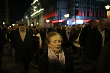 Members of the communist-affiliated PAME trade union take part in a protest demanding the end to austerity measures which have affected wages, pensions and jobs, implemented by the government in Athens