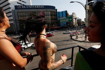 """Exotic models and porn actresses stand on the top of a bus to promote the """"Expo Sex and Eroticism"""" adult exhibition in Mexico City"""