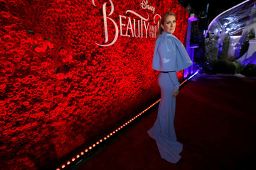"""Recording artist Dion poses at the premiere of """"Beauty and the Beast"""" in Los Angeles"""