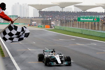 Mercedes driver Lewis Hamilton of Britain gets the checkered flag to win the Chinese Formula One Grand Prix at the Shanghai International Circuit in Shanghai