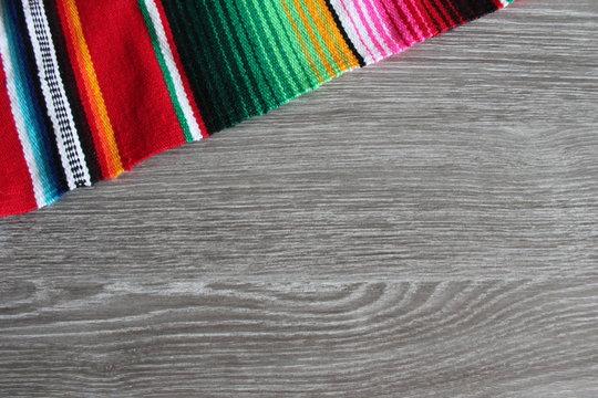 poncho serape background Mexican cinco de mayo fiesta wooden copy space stock, photo, photograph, image, picture,
