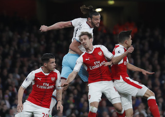 West Ham United's Andy Carroll in action with Arsenal's Nacho Monreal and Granit Xhaka