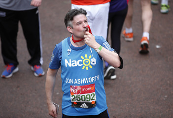 MP Jon Ashworth celebrates with his medal after finishing the marathon
