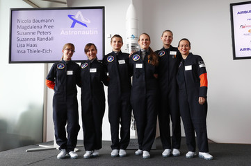 Applicants pose for a picture during a media event where German Economy Minister Zypries will present Germany's first female astronauts at the Brandenburg Gate in Berlin