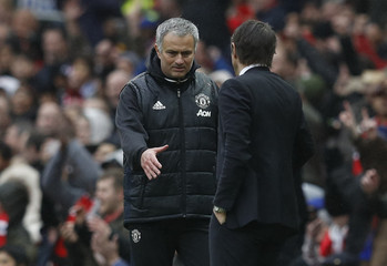 Manchester United manager Jose Mourinho and Chelsea manager Antonio Conte shake hands at the end of the match