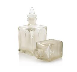 Old perfume bottle on white background. Isolated