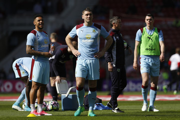 Burnley's Andre Gray (L), Sam Vokes and Michael Keane warm up before the match