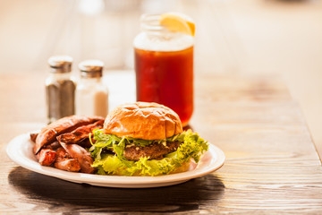 Bleu Onion Burger with sweet potato wedges and an ice tea