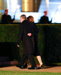 Former German President Joachim Gauck (R) and his partner Daniela Schadt leave after a Grand Tattoo to bid farewell to Gauck at the presidential Bellevue palace in Berlin