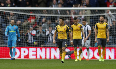 Arsenal's Alexis Sanchez looks dejected after West Bromwich Albion's Craig Dawson scored their third goal