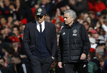 Manchester United manager Jose Mourinho and Chelsea manager Antonio Conte at half time